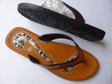lady blowing pvc slipper with good design