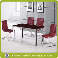 Hot sale wine red tempered glass top stainless steel dining table set