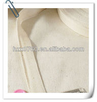 Knitted wide mesh ribbon for disposable hospital gowns