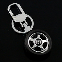 Promotional gift rubbuer metal 3D custom tire keychain with logo custom design