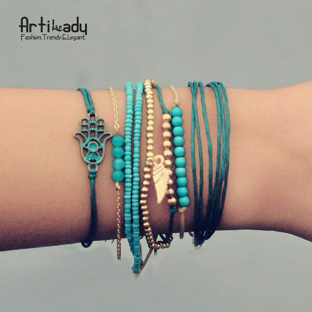 Artilady turquoise beads bracelets set vintage zinc alloy gold beads wing multilayer bracelet bangles for women jewelry