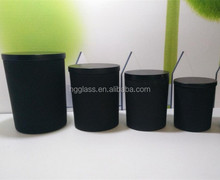 different size black glass candle holder with wooden lid