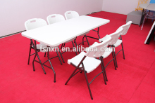 Wholesale plastic fan back folding chair with metal legs