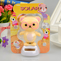 dashboard flip flap solar toy love doll