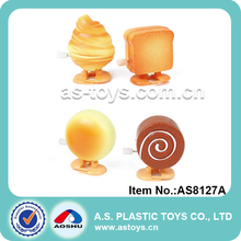 promotion mini plastic walking bread and cake wind up toy for baby