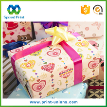 The gift wrap company rolls holiday gift wrap paper