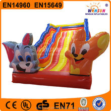 Durable 0.55mm PVC double lane inflatable slide with Tom and Jerry models