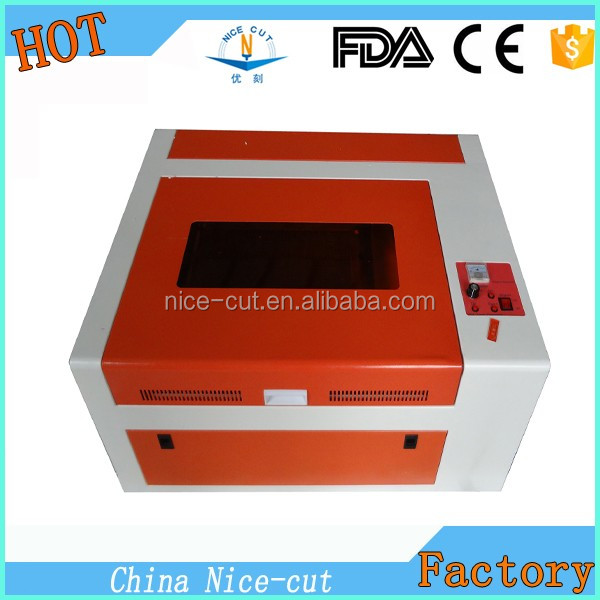 desktop mini 40W Co2 rubber stamp/wood/acrylic/paper laser engraving cutting machine for sale