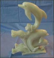 Stone Carving Three Dolphins On Waves - DHUH682