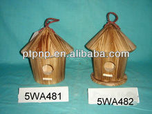 burned wooden bird house