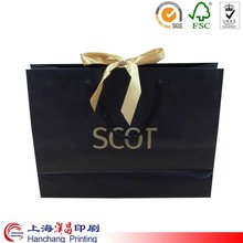 colorful paper gift bags with ribbon handles