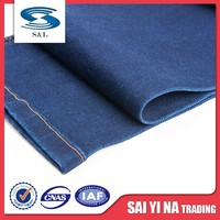 Stock lot poly cotton spandex blue woven denim fabric for jeans garment