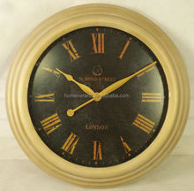 Antique gold metal wall Roman numeral clock