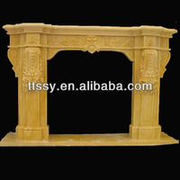 yellow sandstone carved fireplace mantel