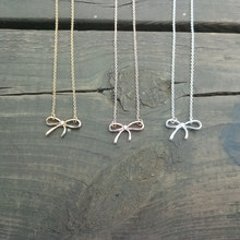 Gold dainty tiny bow charm necklace