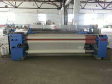 Double nozzle weaving carpet air jet loom with cam shedding