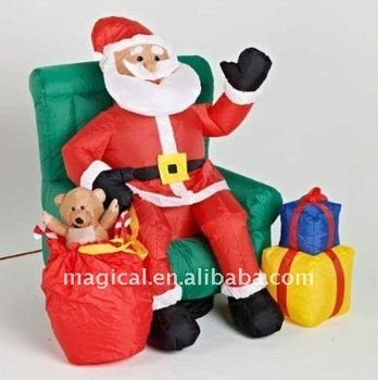 2015 popular inflatable christmas santa claus sitting on chair for party