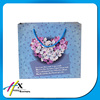 alibaba china 2016 new product customized blue flower paper shopping bag gift bag
