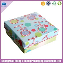 Colorful paper christmas elf presents and christmas gifts box