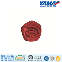 Fresh red satin ribbon rose for clothing decoration