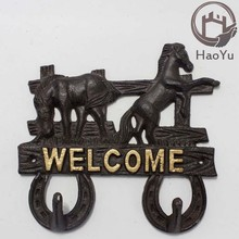 two horse shaped decorative cast iron wall hook