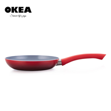 Pressed red pan with long handle