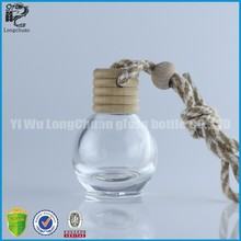 Tiny glass hanging car air freshener refill bottle