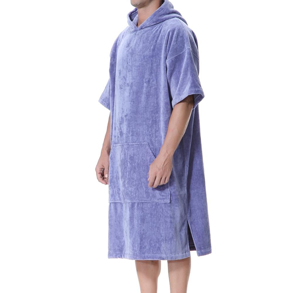 Changing poncho <strong>towel</strong> for surfing