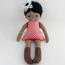 Dark skinned cloth rag doll black hair pink dress and brown polka dot tights