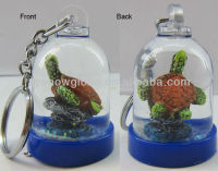 Small plastic snow globe for key ring