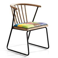 Elegant iron leg and solid ash wood back chair with a variety of bolster colors