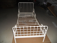 White color metal infant bed