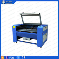 low cost plastic laser cutting machine 1060 for candle holder making