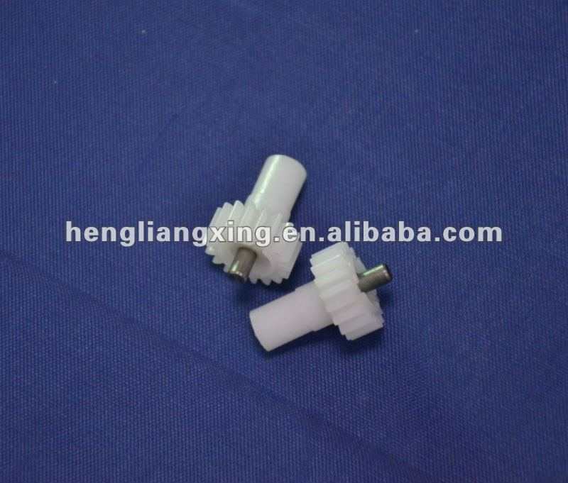 Small plastic spur gear with metal shaft