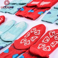Safety and cosy style custom wholesale cute baby non slip vivid color silicon latex rubber socks