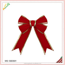 red velvet fabric giant gift bow with gold sides