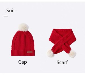 Girl 's warm winter fashion scarf and hat suit