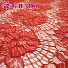 China factory wholesale sequence flower cord lace fabric coral color