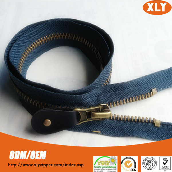 Zippers wholesale fancy slider metal zipper with silicone zipper puller