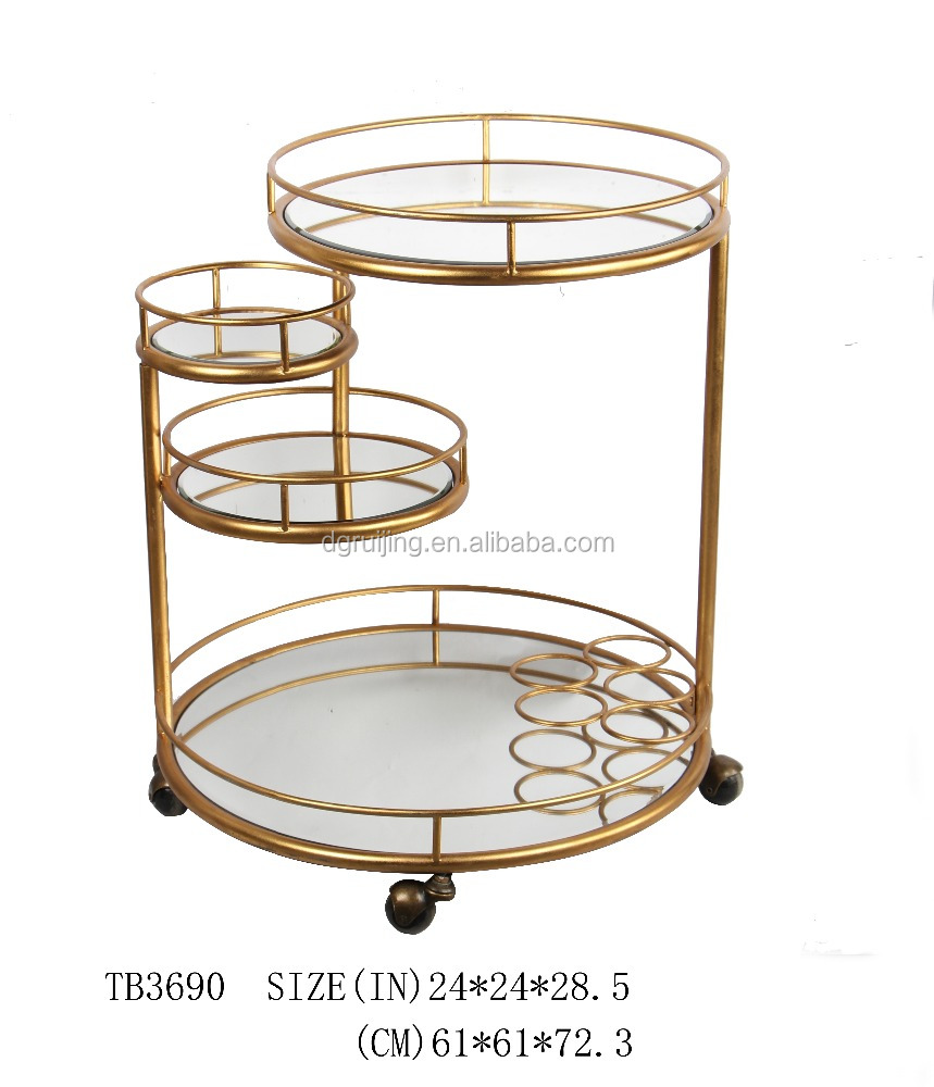 Modern gold leaf bar cart with wine serving