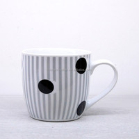 white and black ceramic coffee cup