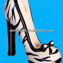 Black and white ceramic high-heeled shoe