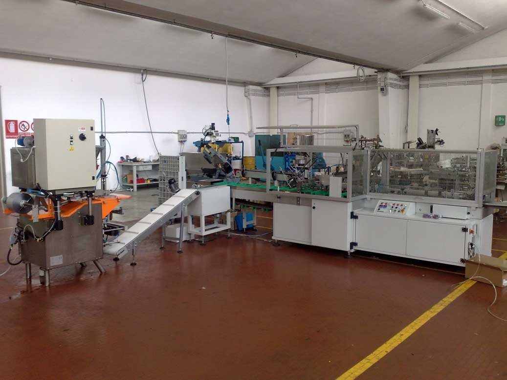 COMPLETE LINE MOLASES TOBACCO: Dosing, packaging, cartoning. machine