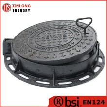 hinged manhole cover with locking system