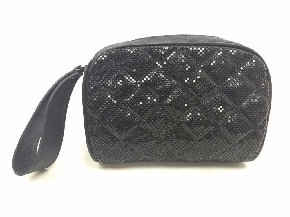 Quilted metal mesh cosmetic bag with wristlet
