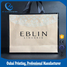 Printed wedding gift luxury clothing packaging bag / Custom paper bag with logo