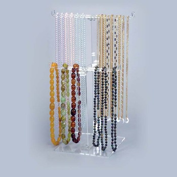 Used clear plastic small jewelry roll storage display