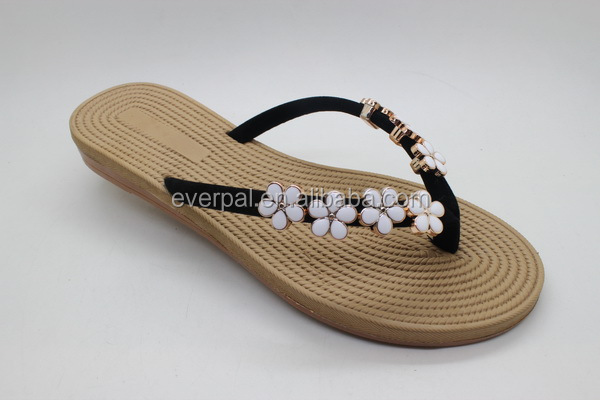 Flip Flops With Slide Charms On The Top