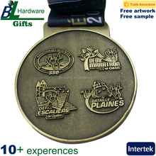 Round heavy antique SSQ marathon medals with Canada events