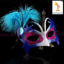 Beautiful and colorful mixed feather venetian mask with pretty handwork flower
